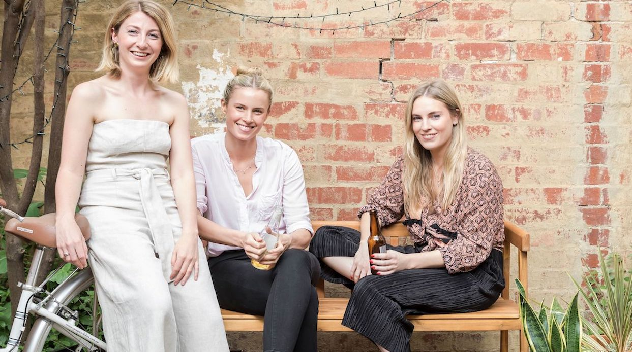"Emily Hutchinson (left) was inspired by her own time spent with roommates, including two old school friends, Maddy (middle) and Felicity Burke (right). ""Living with them was so much fun – going to sleep and waking up with your friends every day is a special thing,"" said Hutchinson. (Photo by Pablo Veiga)"