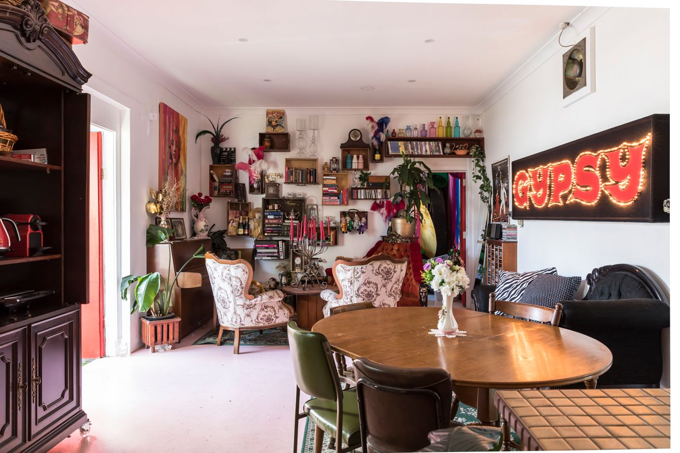 "This home is shared between Brendan De La Hay, Alicia Quinn and Roxanne Van Zyl, all performers based in Sydney. The house has ""a touch of showbiz to it,"" including the sign from the stage musical Gypsy. (Photo by Pablo Veiga)"