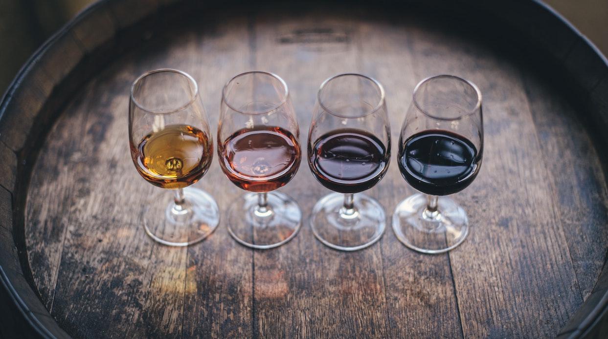 Four half-filled wine glasses