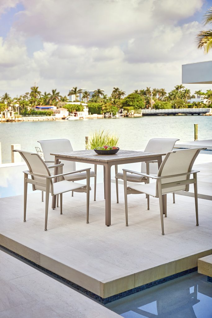 Light gray small dining table and chairs from the Adapt Collection at Brown Jordan