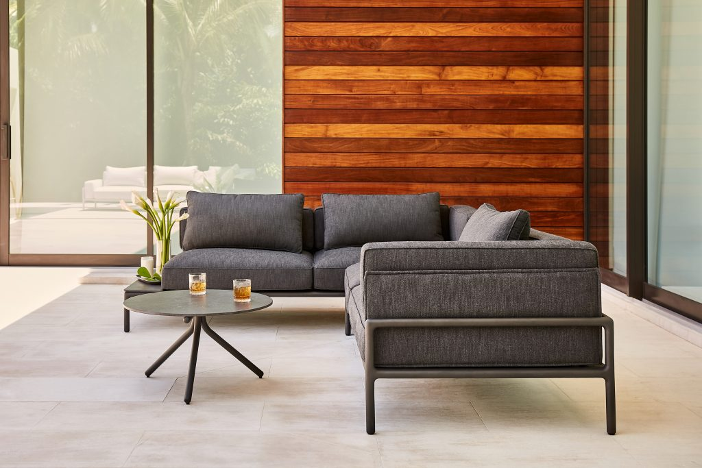 Neutral dark gray outdoor sofa and table from the MOTO Collection by Brown Jordan
